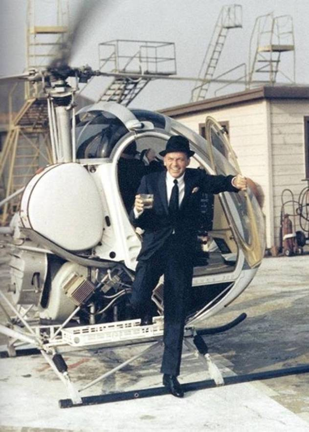 60f9b6ed7c5f Frank Sinatra stepping out of a helicopter with a drink.